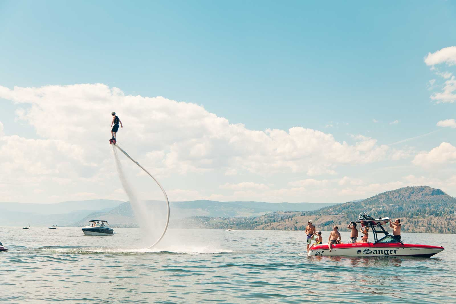 showing of some flyboarding above a boat in Kelowna BC Canada